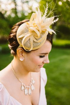 fascinator for the bridesmaid, photo by Zac Wolf http://ruffledblog.com/mile-away-restaurant-wedding #weddingideas #bridesmaids