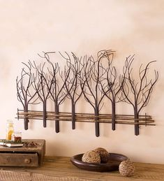 Metal and Natural Vine Tree Wall Art | Our Metal and Natural Vine Tree Wall Art calls to mind a walk on a winter's day. Leafless metal trees and a serpentine fence crafted from vines combine to form a handsome piece of wall art that is elegant in its simplicity.