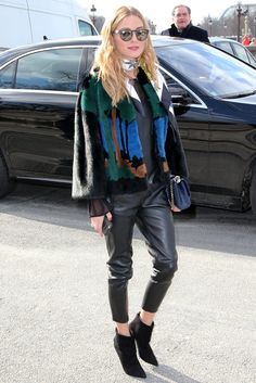 Olivia added interest to all black with a printed furry jacket, skinny scarf, and Westward Leaning shades. ...