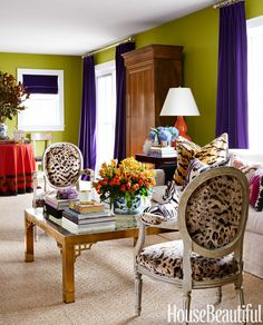"""Allen transformed the main room by painting it in Benjamin Moore's Split Pea. """"I love green and purple together,"""" he says. """"It's very Palm Beach."""" Chairs in Cowtan & Tout fabric. Curtains in a Kravet velvet. - HouseBeautiful.com"""