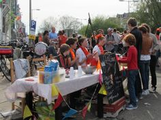 Koninginnedag (queensday) in East Amsterdam, the Netherlands. Koninginnedag is an annual traditional festival. On this day the Dutch celebrates the anniversary of the former queen (April 30th). Dutch wear orange and sell their old stuff in almost every street in Holland.
