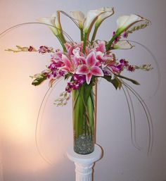 altar/buffet flowers featuring ivory callas, pink stargazer lilies and pink dendrobium orchid sprays