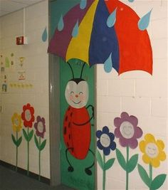 This ladybug holding an umbrella is a colorful display idea for spring.  Student faces could be placed in the center of the flowers and the raindrops could have words written on them related to the display.