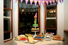 Tangled Party Decor, Food and Free Printables!  Love that the cupcake tower looks not so labor intensive.