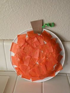 Tissue paper pumpkin.  Add some black tissue or construction paper to make a jack o lantern.