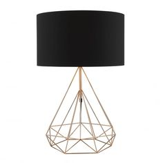 A modern copper wire frame table lamp complete black shade.