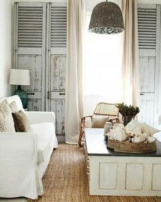 Love the basket of shells and shabby shutters