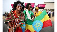 Fans of Ethiopia arrive @ Opening Ceremony. Love the joy & bright colors.