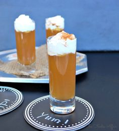 Apple Pie Shooter Cocktail topped with whipped cream and pumpkin pie spice! - The Foodie Affair