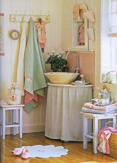 I like the towel rack and the idea of putting loops on the corner of my towels. I would want to have the towel rack also have a shelf incorporated above it like the one in robin egg color bathroom I pinned