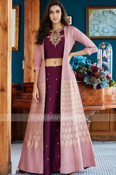 Designer dresses indian - Cast a spell as you wear this flattering magenta designer lehenga choli set featuring zari worked motifs enriching the lehenga while choli stands out in zari & gota embroidery at the neckline in a stu Indian Fashion Dresses, Indian Gowns Dresses, Dress Indian Style, Indian Designer Outfits, Party Wear Indian Dresses, Lehenga Choli Designs, Kurta Designs, Stylish Dress Designs, Designs For Dresses
