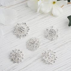 Look for Glamorous Diamond Crystal and Rhinestone Accessories here at eFavorMart for Decorations. Introducing Floral Design Diamond Sash Pins, Silver Polished Rhinestone Brooches, Brooch Bouquet Decors, and Diamond Crystal Bouquet Pins. Wedding Chair Sashes, Wedding Chairs, Floral Centerpieces, Floral Arrangements, Silver Wedding Decorations, Crystal Bouquet, Floral Pins, Flower Mandala, Mandala Design