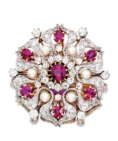 PLATINUM, GOLD, RUBY, DIAMOND AND PEARL BROOCH, PICKSLAY & CO. The stylized flowerhead centering a round ruby weighing approximately .90 carat, framed by six oval-shaped rubies and six pearls measuring approximately 3.2 mm, accented by old European and rose-cut diamonds weighing approximately 2.20 carats, signed Pickslay & Co.; circa 1900