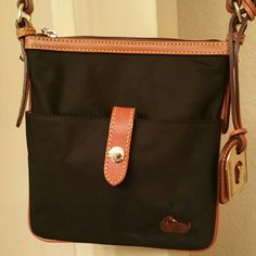 DOONEY NYLON CROSSBODY DOONEY NYLON CROSSBODY. NWOT. HAD BRITISH TAN LEATHER. INSIDE ZIP POCKET. 1 SLIP POCKET. 1 KEY KEEPER ATTACHED INSIDE. BLACK WITH PINK DETAIL INTERIOR. Dooney & Bourke Bags Crossbody Bags
