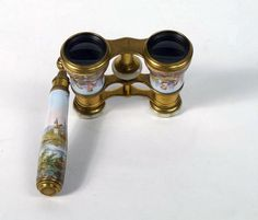 Lemaire Fabi, Paris, a pair of early 20th century hand painted opera glasses, having enamel decoration depicting lovers seated in landscape, with mother of pearl eye caps - Price Estimate: £150 - £250