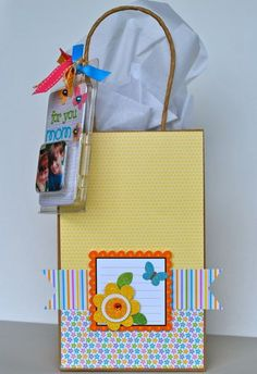 reuse brad packaging to make a tag...brilliant.  By Aphra Bolyer for Doodlebug