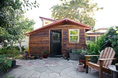 This small studio house plan was a labor of love, and became a sweet retreat for the couple who clearly put their heart and soul into the design. This small California house design is an inspiring studio space for homeowners architect Sarah Deeds of Deeds Design and carpenter John McBride, who together designed and built this 120-sq.-ft. book nook in the woods. Surrounded by trees and wild yet thoughtful landscaping, this wood clad house is right at home here.