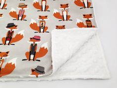 Lovely custom made handmade baby blanket using all over designer quality cotton Robert Kaufman Fox and the Houndstooth fabric. The blanket has a