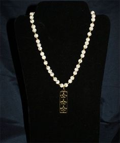 three tier Fleur De Lis Necklace. Classy one of a kind piece.