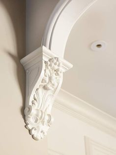 Decorate with Trim - Decorative trim adds an instant stamp of personality to any space. Consider adding decorative details such as this cornice and arch treatment to soften the abrupt transition between a curved entryway and the adjoining wall