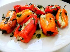 Mini Peppers  stuffed them with a mixture of herbed goat cheese and mascarpone, put them back in the oven for a few seconds just to get the cheese warm and then drizzled a flavored lemon olive oil and herb dressing over the top.