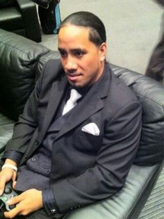 Jey Uso with a weight of 103 kg and a feet size of N/A in favorite outfit & clothing style