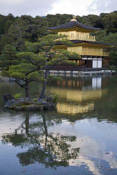 Kinkakuji in Kyoto Japan.  Kinkaku-ji translates to Temple of the Golden Pavilion.  It is a Zen Buddhist temple set in classically designed Japanese gardens.