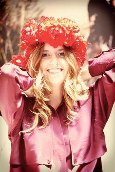 KS intern Elizabeth tries on the floral crown for size. #KendraScott