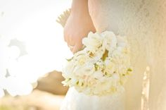 BG342 All white bridal bouquet of lisianthus, freesias and roses