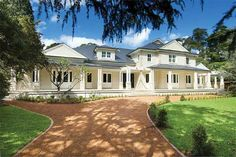 A modern day traditional home finished in Resene Half Spanish White.
