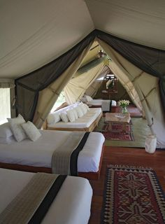 Glamping glamorous camping holidays luxury safari tents - Camping at the lake or in the woods, often amusing.