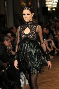 """Lace, feathers and crocheted detail kicked off Toronto Fashion Week festivities Monday night.     Romanian-born fashion designer Lucian Matis showcased his """"Nature's Art in Symmetry"""" fall/winter 2012 collection offsite at The Fairmount Royal York Hotel in downtown Toronto—a lavish yet ideal setting for the somber and abstract collection."""