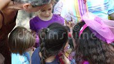 Video about Artist paints on children s faces in Cismigiu park, Bucharest, Romania. Video of artistic, artist, happy - 77397349