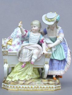 Meissen Model: E 76 Description: Child Playing On Cradle Modeled By: Michel Victor Acier ca. 1774 Mark: E 76 Painter Number: 79 - Hoffmann Height: 8 in - cm Dresden Dolls, Half Dolls, Royal Doulton, China Porcelain, Antique Items, Kids Playing, Clocks, Art Decor, Old Things