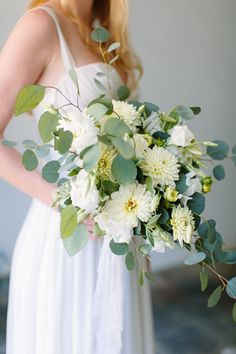 Dahlia, rose and eucalyptus wedding bouquet: Photography : Nicki Metcalf Read More on SMP: http://www.stylemepretty.com/virginia-weddings/williamsburg-virginia/2016/10/25/theres-nothing-quite-like-young-love/