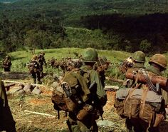 Members of Co. C 1st Bn 8th Inf 1st Bde 4th Inf Div descend the side of Hill 742 located five miles northwest of Dak To. November 14-17 1967. Photo: Flickr/ The U.S. Army.