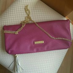 Steve Madden Clutch with strap Beautiful fuchsia and light grey clutch with gold accents. This clutch is new without tags. I bought it and never used it. I love the thought of it but realistically I will never give it the use that it deserves. I comes with a long gold chain strap so it can go on the shoulder when you're tired of carrying it. Perfect accessory for a night out or to glam up your outfit. Steve Madden Bags Clutches & Wristlets