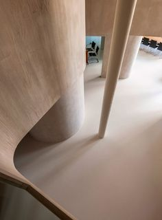 Graux & Baeyens uses curved walls to convert a factory loft into a family home.