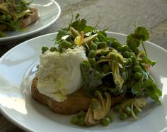 spring bruschetta with local mozzarella, raw carciofi and peas and their shoots.....spring on a piece of bread...
