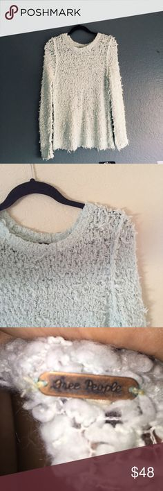 Free People Sweater very very cozy and warm. a little holey, I usually wear with a tank or bralette underneath. it looks whiter in the photo than it actually is. it's a light blue color. worn a couple times but great condition. size small/medium (I don't remember) Free People Sweaters Crew & Scoop Necks