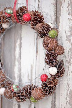 I love this Chicken Wire Pine Cone Wreath! You can fill it with holiday decorations and swap them out when the seasons change. More #crafty chicken wire ideas! backyardpoultrymag.com