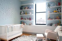 For little baby Anya, designer Chérie Stein made a peaceful room overlooking Washington Square that is full of crafts and creativity to inspire her early years.