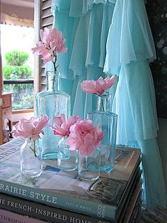 Look at the books on shabby decor and the beautiful fresh flowers.