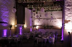 Purple wedding barn decor - lighting and lanterns go a long way towards creating a gorgeous purple wedding decor theme.
