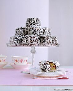 Lamingtons These delectable morsels are best sellers at Australian bake sales and a great accompaniment to afternoon tea. Chocolate Squares, Chocolate Icing, Mini Cakes, Cupcake Cakes, Cupcakes, Lamingtons Recipe, Just Desserts, Dessert Recipes, Cheesecake Recipes