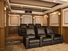 Custom seats for six complement an overall entertainment space that invites both family and guests to experience films and games in a luxurious, user-friendly atmosphere.