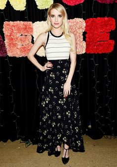Emma Roberts wears a striped tank top with a floral maxi skirt and t-strap heels