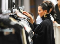 Kim Kardashian from The Kardashians at DASH  Kim peruses the racks at the sisters' DASH boutique in NYC.