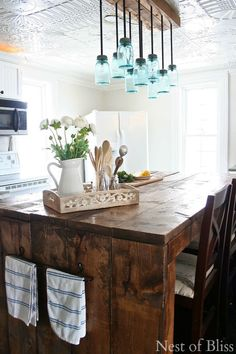 Let this Mason jar chandelier illuminate your workspace, while adding country style to your kitchen.  Get the tutorial at Brandi Sawyer.   - CountryLiving.com