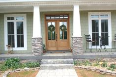 Double front doors with transom-but add double door handles and painted/colored not wood